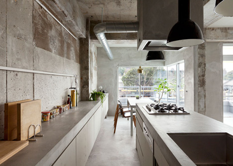 Bare-concrete-apartment-by-Airhouse-Design-Office-presents-its-own-fashion-exhibitions_dezeen_1
