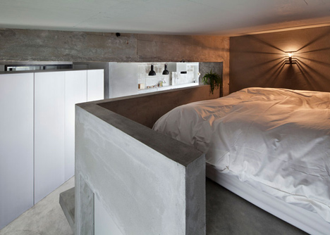 Bare-concrete-apartment-by-Airhouse-Design-Office-presents-its-own-fashion-exhibitions_dezeen_11