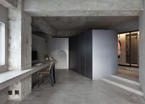 Bare-concrete-apartment-by-Airhouse-Design-Office-presents-its-own-fashion-exhibitions_dezeen_13