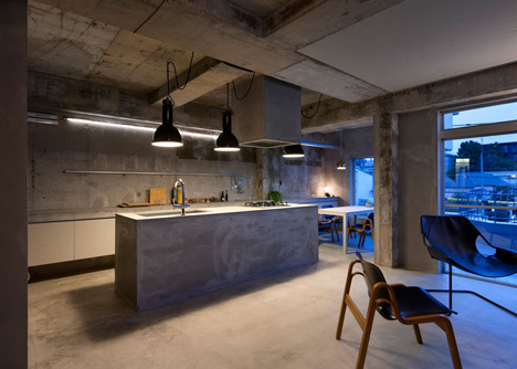 Bare-concrete-apartment-by-Airhouse-Design-Office-presents-its-own-fashion-exhibitions_dezeen_15