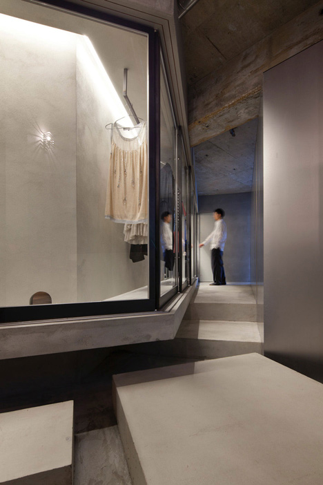 Bare-concrete-apartment-by-Airhouse-Design-Office-presents-its-own-fashion-exhibitions_dezeen_16