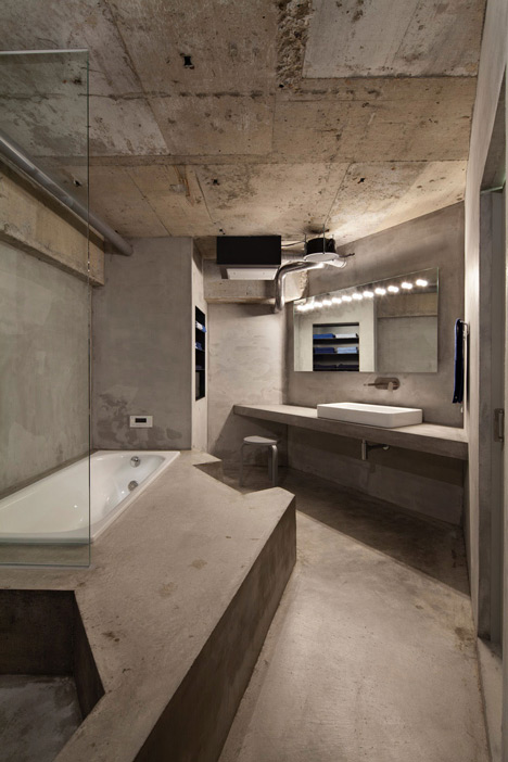 Bare-concrete-apartment-by-Airhouse-Design-Office-presents-its-own-fashion-exhibitions_dezeen_17