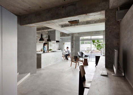 Bare-concrete-apartment-by-Airhouse-Design-Office-presents-its-own-fashion-exhibitions_dezeen_2