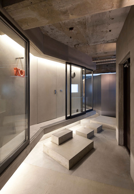 Bare-concrete-apartment-by-Airhouse-Design-Office-presents-its-own-fashion-exhibitions_dezeen_4