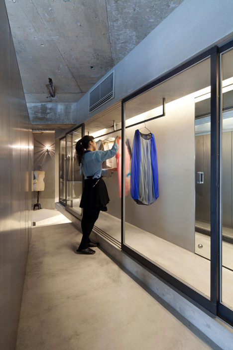 Bare-concrete-apartment-by-Airhouse-Design-Office-presents-its-own-fashion-exhibitions_dezeen_7